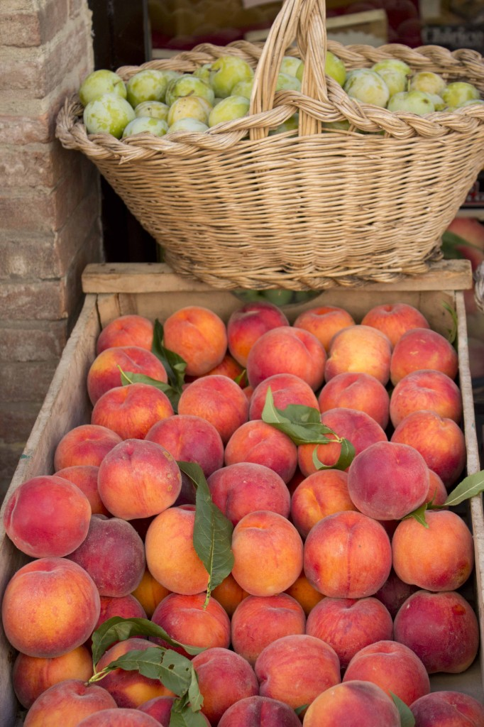 Peaches and plums at a fruit stand in Montepulciano