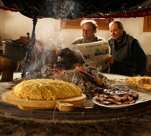 Polenta on a fogolar (traditional Friulian fireplace) by Elido Turco