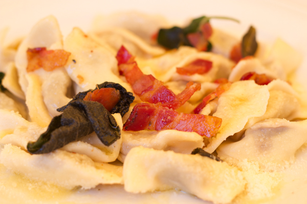 Casoncelli (fresh pasta stuffed with cured meats, bread, cheese and egg)