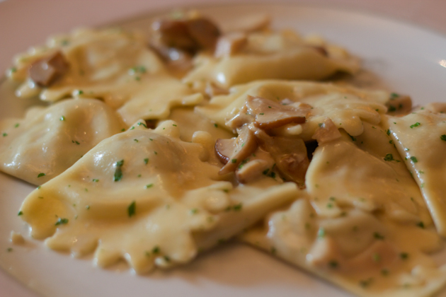 Casunziei ai porcini (ravioli filled with cheese and mushrooms in a porcini mushroom sauce)