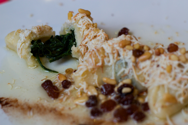 Cjalsions (fresh pasta stuffed with spinach in a melted butter, raisin, pine nut and cinnamon sauce)