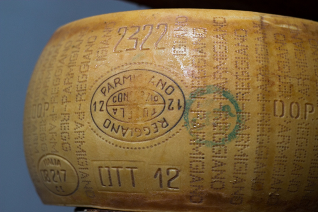 A wheel of Parmigiano-Reggiano cheese (the real Parmesan)