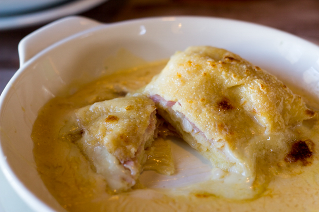 Crespelle di farro ripiene con prosciutto cotto, crema di castagne e toma cotta nel salsa di fonduta (Spelt crepes filled with ham, chestnut and toma cheese baked in fondue)