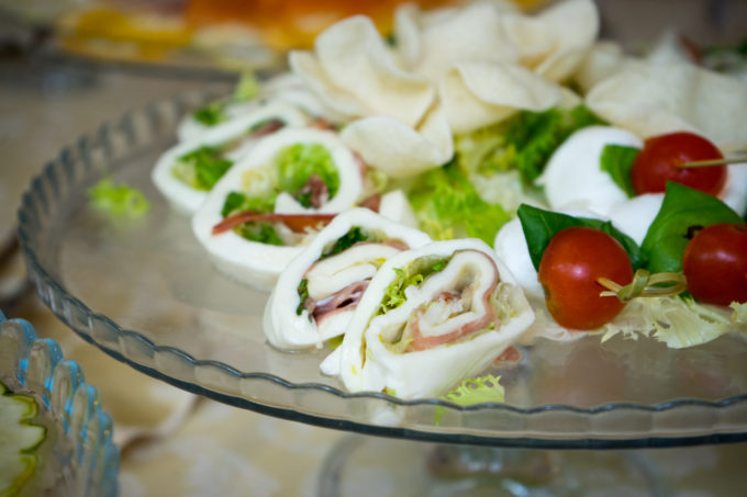 Mozzarella rolled with salad and prosciutto