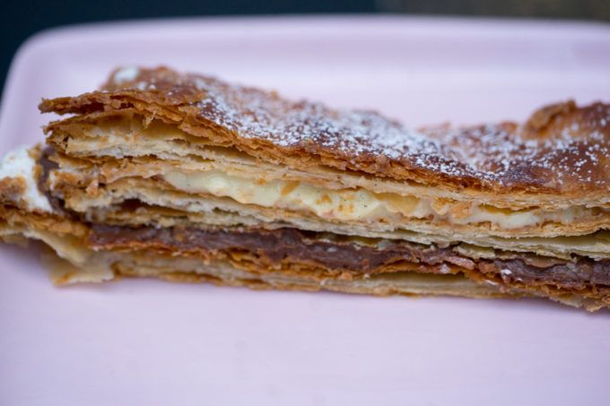 A slice of agnello di sfoglia: layers of puff pastry, vanilla custard and chocolate custard
