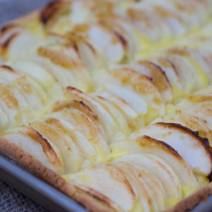 Apple tart: caramelised apples with vanilla custard baked in a crisp shell