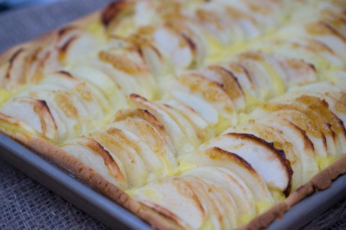 Apple tart: caramelised apples with vanilla custard baked in a crisp shell