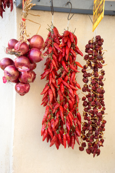 Tropea onions, spicy chillies (jokingly referred to as Calabrian viagra) and sweet chillies hanging