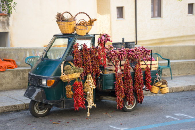 A tre ape (three wheeled vehicle typical in Italy) selling local ingredients such as chillies, garlic, onions and oregano