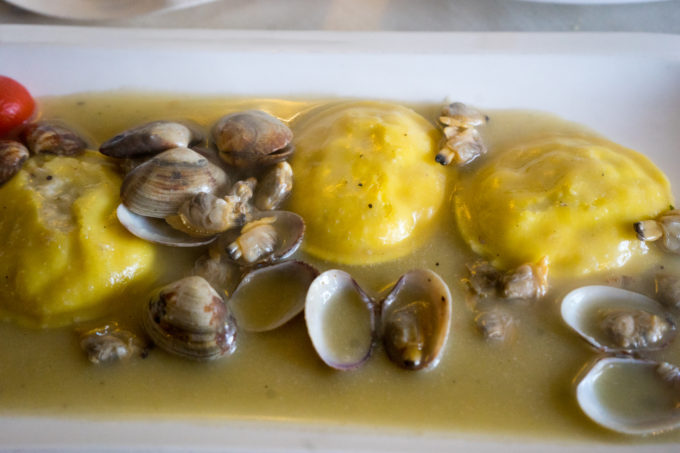 Fish ravioli with clams