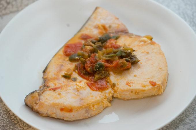 Pesce spada alla siciliana (swordfish with capers, olives and tomatoes) – Sicilia