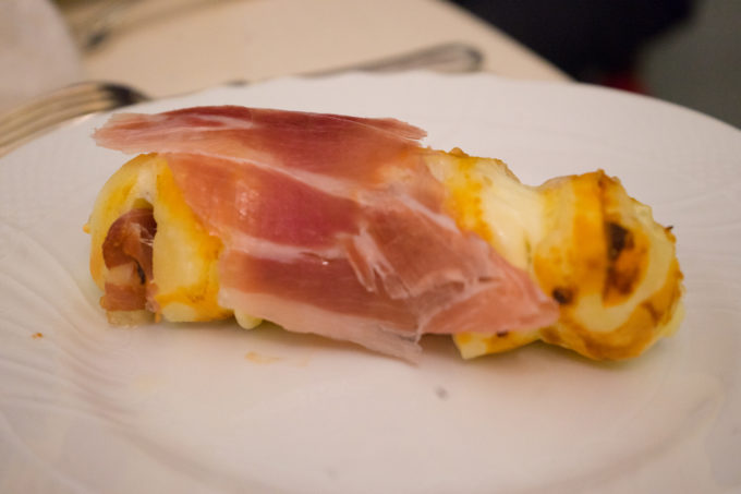 Grilled scamorza cheese with prosciutto