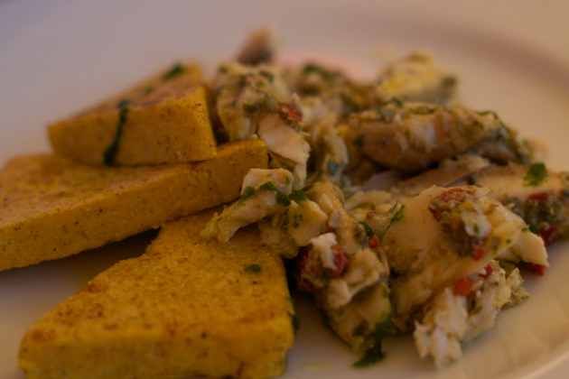 Luccio in salsa (salt cod cooked with capers, parsley, peppers and anchovies served with grilled polenta)