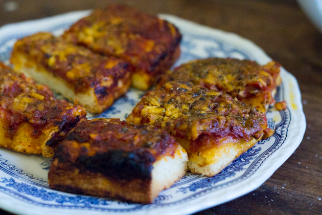 sfincione alla palemeritana (a thick soft pizza topped with anchovy, onion, tomato and caciocavallo cheese)