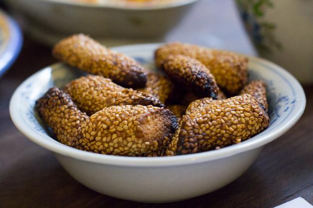 Biscotti regina (left- shortbread biscuits rolled in sesame seeds)