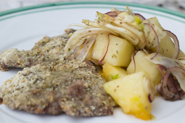 Vitello alla palermitana (herb coated veal escalopes) with insalata di melone (melon and fennel salad)