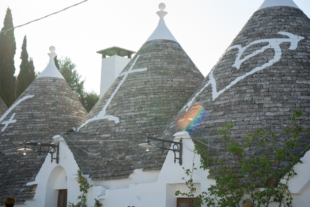 Trulli houses in Alberobello with Christian symbols whitewashed onto the roofs