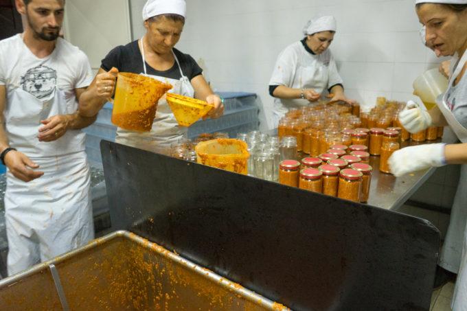 Making various fiery sauces at Delizie Vaticane