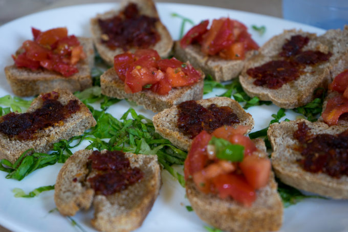 Tomato bruschetta and 'nduja spread on toast