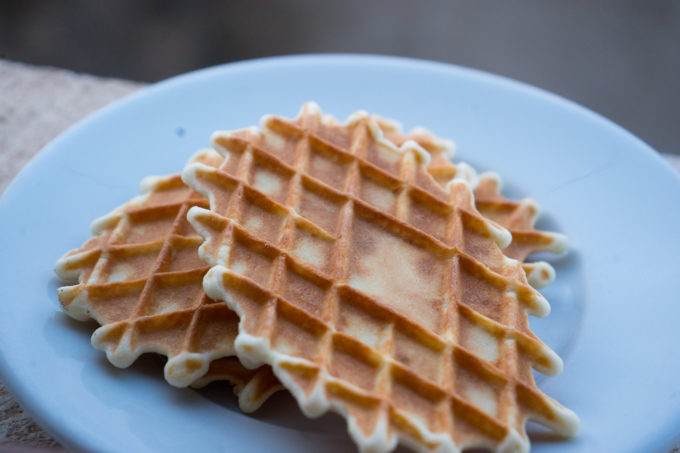 Ferratelle (anise-flavoured waffle biscuits typical of Abruzzo) which can be served with icing sugar, sandwiching grape jam or rolled and stuffed with sweet saffron-flavoured ricotta, custard or chocolate custard